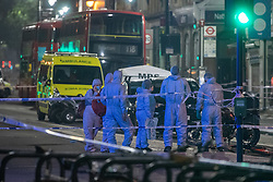 © Licensed to London News Pictures. 22/07/2021. London, UK. Forensic investigators at the scene following a fatal stabbing on Brixton Road, Brixton. Metropolitan Police Service (MPS) were called at 20:18BST on Wednesday 21 July to reports of an assault close to Brixton Underground Station. Despite efforts from police officers, paramedics from London Ambulance Service (LAS) and London's Air Ambulance the man was pronounced dead at the scene at the 20:45BST. Photo credit: Peter Manning/LNP