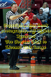 17 December 2014: Referee Brad Ferrie calls a player contact foul during an NCAA Men's Basketball game between the Skyhawks of University of Tennessee - Martin and the Redbirds of Illinois State at Redbird Arena in Normal Illinois