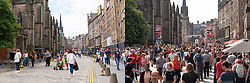 Edinburgh, Scotland, UK. 6th August  2021.  Images from the Royal Mile in Edinburgh Old Town on the opening day of the Edinburgh Fringe Festival 2021.  The festival looks very different from two years ago . Very few street performance spaces are permitted and far fewer tourists are evident. Also a high police visibility, there are more police officers than performers on the street, is in marked contrast to previous years. Pic; Montage image of Royal Mile today on left and on opening day of festival in 2019. Iain Masterton/Alamy Live news.