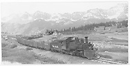 """RGS #455 departing Lizard Head southbound with 16 cars going 5 mph.<br /> RGS  Lizard Head, CO  Taken by Kindig, Richard H. - 6/5/1951<br /> In book """"Rio Grande Southern, The: An Ultimate Pictorial Study"""" page 143<br /> Also at RD169-036.  Also in """"Silver San Juan"""", p. 536; """"Narrow Gauge Country 1870-1970"""", p. 258 and """"RGS Story Vol. IV"""", p. 305."""