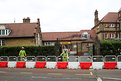 © Licensed to London News Pictures. 29/08/2020. London, UK. Workmen install barriers for social distancing at the entrance of Chestnuts Primary School in Tottenham, north London, as the school prepares for reopening next week, at the start of the new academic year. The council and the school are putting in place measures for social distancing and safe conditions following the coronavirus pandemic. Photo credit: Dinendra Haria/LNP