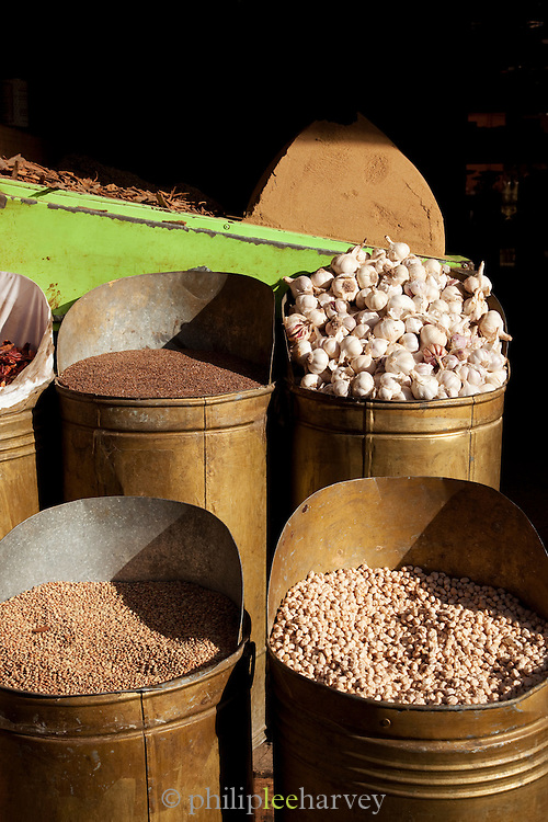 Seeds and garlic for sale at stall in the Djemaa el Fna in the medina of Marrakech, Morocco
