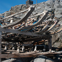 Vintage dogsleds are stacked outside a hut at Port Lockroy, an abandoned British Science base on Goudier Island, Antarctica that has been restored as a museum.