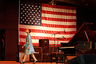 East Meadow, New York, U.S. October 15, 2008. SHEIMYRAH MIGHTY, a 10-year-old Haitian American singer, walks across stage of Harry Chapin Theater to leave after singing God Bless America during Obama Rally at Eisenhower Park.