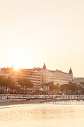 Carlton Intercontinental Hotel over sea front at sunset, Cannes, France
