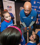 Former NBA play John Lucas talks with students during a financial education and success program sponsored by NBA Cares and BBVA Compass at Crespo Elementary School, February 27, 2014.