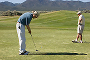 Two golfers at high desert golf course, New Mexico