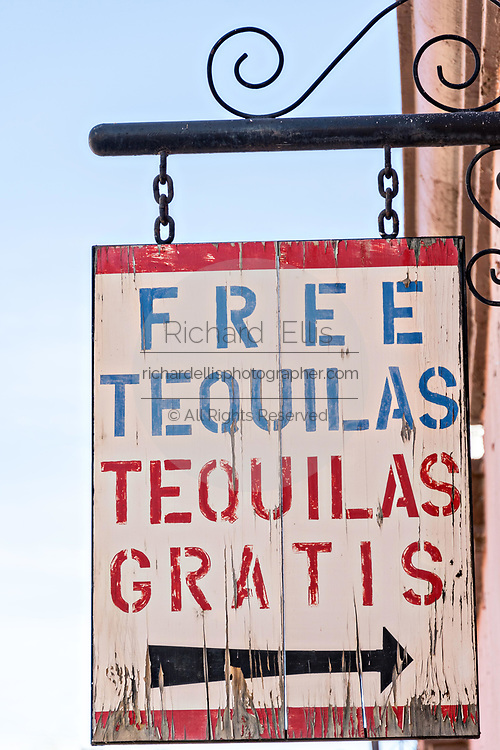 A wooden sign advertising free Tequila in the beautiful colonial village of Bernal, Queretaro, Mexico. Bernal is a quaint colonial town known for the Pena de Bernal, a giant monolith which dominates the tiny village is the third highest on the planet.