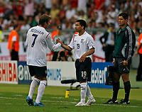 Photo: Glyn Thomas.<br />England v Ecuador. 2nd Round, FIFA World Cup 2006. 25/06/2006.<br /> England's David Beckham (L) is replaced by Aaron Lennon.
