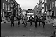 Cork Shoe Workers Protest.     K15..1976..24.03.1976..03.24.1976..24th March 1976..In protest at the winding up of the Cork shoe industry, 10 workers  from the Cork Shoe Co marched from Cork to Dublin to meet with TDs at Leinster House. The protest was to highlight the closure of The Cork shoe Co resulting in the unemployment of all the staff..Image of the ten workers from The Cork Shoe Co approaching Leinster House at the end of their long walk from Cork City.