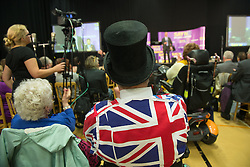 © Licensed to London News Pictures. <br /> <br /> Pictured: A member of the crowd wearing a Union Jack Jacket at the UKIP Say NO to EU Tour in Gloucester, England.<br /> <br />  Photo credit should read Max Bryan/LNP
