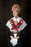 Isabelle, member of the Heimat- und Trachtenverein der Börde Elsdorf e.V., is wearing a traditional costume in Elsdorf, Lower Saxony, Germany on March 10, 2018.<br /> <br /> Groom: Abdulrahman<br /> <br /> The traditional costume and the bridal crown are replicas of the original costumes.