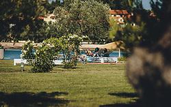THEMENBILD - Touristen entspannen auf einer weißen Strandliegen in der Sonne, aufgenommen am 05. Juli 2020 in Novigrad, Kroatien // Tourists relax on a white beach chair in the sun, in Novigrad, Croatia on 2020/07/05. EXPA Pictures © 2020, PhotoCredit: EXPA/ Stefanie Oberhauser