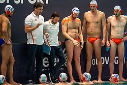 Coach Harry van der Meer, Thomas Lucas, Jorn Muller of the Netherlands in action against Romania during the Olympic qualifying tournament. The Dutch water polo players are on the hunt for a starting ticket for the Olympic Games on February 16, 2021 in Rotterdam