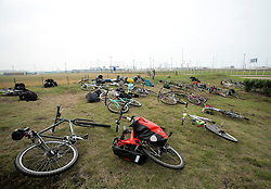 """© Licensed to London News Pictures. 30/08/2015. Calais, France. Around a hundred British cyclists from """"Critical mass to Calais"""" gather at their arrival to Calais from London as they are to donate bicycles to the people in the refugee camp, also known as the Jungle, as well as supplies to support the life at the site. Photo credit : Isabel Infantes/LNP"""