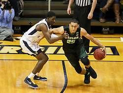 Jan 9, 2018; Morgantown, WV, USA; Baylor Bears forward Tristan Clark (25) dribbles the ball during the first half against the West Virginia Mountaineers at WVU Coliseum. Mandatory Credit: Ben Queen-USA TODAY Sports
