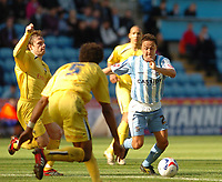 Photo: Leigh Quinnell.<br /> Coventry City v Preston North End. Coca Cola Championship. 01/04/2006. Coventrys Dennis Wise is surrounded by Preston players as he attacks goal.