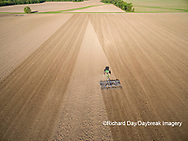 63801-10204 Farmer tilling field before planting corn-aerial Marion Co. IL