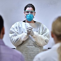BOSTON, 3/5/2020 -  Registered Nurse Meredith Fahy, Infection Preventionist, conducts an exercise in donning and doffing protective gear for medical residents at Massachusetts General Hospital. Since supplies were limited and deliveries unreliable, The students were only able to watch Fahy demonstrate with gear that she reused in multiple demonstrations. Josh Reynolds for for The Washington Post  (Bronwen Latimer, Emma Brown)