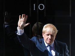 © Licensed to London News Pictures. 24/07/2019. London, UK. Boris Johnson waves from the steps of 10 Downing Street as Prime Minister for the first time. Photo credit: Rob Pinney/LNP