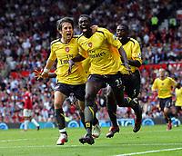 Emmanuel Adebayor celebrates scoring goal with team mates Tomas Rosicky and Emmanuel Eboue<br />Arsenal 2006/07<br />Manchester United V Arsenal (0-1) 17/09/06<br />The Premier League<br />Photo Robin Parker Fotosports International