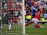 Photo: Rich Eaton.<br /> <br /> Barnsley v Cardiff City. Coca Cola Championship.<br /> <br /> 05/08/2006. Darren Purse tries to score after missing yhe penalty as Barsnleys Paul Hayes puts in a tackle