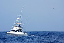 Sport fishing boat, Ihu Nui, with Hawaiian 'Green Stick' tuna rig, off Kona Coast, Big Island, Hawaii, USA, Pacific Ocean