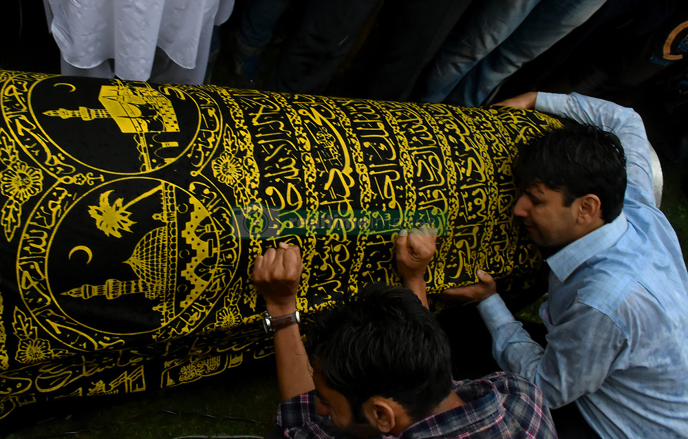 June 15, 2018 - Baramullah, Jammu and Kashmir, India - A man breakdown at the coffin of Shujaat Bukhari, slain Editor-in-Chief of the Kashmir Based Local English daily newspaper Rising Kashmir, during his funeral at Kreeri area of Baramullah District of Indian Administered Kashmir on 15 June 2018. Bukhari was killed after unknown gunmen shot on his vehicle killing Bukhari and two of his Body Guards. However, no Kashmir militant group has claimed the responsibility and has urged United Nations to probe the Killing of the Senior Editor internationally. (Credit Image: © Muzamil Mattoo/Pacific Press via ZUMA Wire)