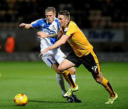 Lee Mansell of Bristol Rovers challenges Liam Hughes of Cambridge United - Mandatory byline: Neil Brookman/JMP - 07966 386802 - 30/10/2015 - FOOTBALL - The Abbey Stadium - Cambridge, England - Cambridge United v Bristol Rovers - Sky Bet League Two