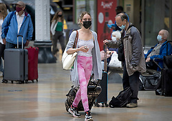 © Licensed to London News Pictures. 05/07/2021. London, UK. Members of the public are seen wearing face masks at Paddington Station in West London. Later today the Prime Minister Boris Johnson will announce a final lifting of Covid-19 regulations on July 19th. Photo credit: Ben Cawthra/LNP
