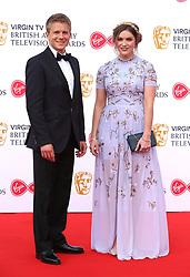 George Rainsford and Alicia Munroe attending the Virgin TV British Academy Television Awards 2018 held at the Royal Festival Hall, Southbank Centre, London. PRESS ASSOCIATION Photo. Picture date: Sunday May 13, 2018. See PA story SHOWBIZ Bafta. Photo credit should read: Isabel Infantes/PA Wire