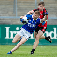 Cratloe's David Collins is tackled by Clondegad's Tony Kelly
