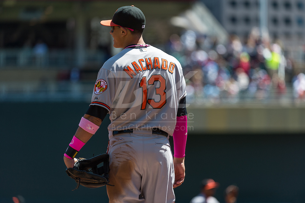 Manny Machado #13 of the Baltimore Orioles looks on during a game against the Minnesota Twins on May 12, 2013 at Target Field in Minneapolis, Minnesota.  The Orioles defeated the Twins 6 to 0.  Photo: Ben Krause
