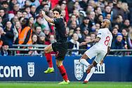 Šime Vrsaljko (Croatia) & Fabian Delphi (England) following heading the ball during the UEFA Nations League match between England and Croatia at Wembley Stadium, London, England on 18 November 2018.