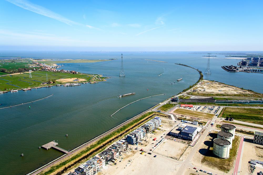 Nederland, Noord-Holland, Amsterdam, 20-04-2015; Zeeburgereiland met silo's van de voormalige rioolwaterzuivering Zeeburg en zelfbouwkavels. Foto Buiten-IJ met links Durgerdam en rechst IJburg.<br /> Island Zeeburg, Amsterda East, former sewage treatment paltm and industrial ares, now new urban developement.<br /> <br /> luchtfoto (toeslag op standard tarieven);<br /> aerial photo (additional fee required);<br /> copyright foto/photo Siebe Swart