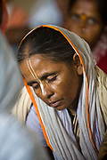 Widows chant in an ashram for a meagre allowance of money. Abandoned by their famiies they are dumped in  the holy city of Vrindavan, India.