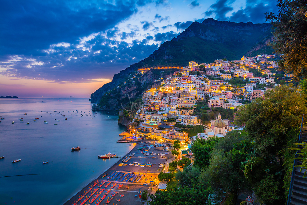"""Positano is a village and comune on the Amalfi Coast (Costiera Amalfitana), in Campania, Italy, mainly in an enclave in the hills leading down to the coast. <br /> <br /> Positano was a port of the Amalfi Republic in medieval times, and prospered during the sixteenth and seventeenth centuries. By the mid-nineteenth century, however, the town had fallen on hard times. More than half the population emigrated, mostly to America.<br /> <br /> Positano was a relatively poor fishing village during the first half of the twentieth century. It began to attract large numbers of tourists in the 1950s, especially after John Steinbeck published his essay about Positano in Harper's Bazaar in May, 1953: """"Positano bites deep"""", Steinbeck wrote. """"It is a dream place that isn't quite real when you are there and becomes beckoningly real after you have gone."""""""