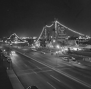 Y-590612-01. Canadian ships lighted on old Harbor Drive seawall (presently Waterfront Park) view from Hawthorne Bridge looking north. June 12, 1959.