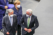 Secretary General of the United Nations, António Guterres (L), German Chancellor Angela Merkel (C), German Federal President Frank-Walter Steinmeier (R) make their way out of the Bundestag in Berlin, Germany, December 18, 2020. Guterres was invited as an honorary guest on the occasion of  the founding of the United Nations 75 years ago. <br /> (Photo by Omer Messinger)
