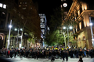 Big police presence as protesters hold up signs at Martin Place during a 'Black Lives Matter' rally on 02 June, 2020 in Sydney, Australia. This event was organised to rally against aboriginal deaths in custody in Australia as well as in unity with protests across the United States following the killing of an unarmed black man George Floyd at the hands of a police officer in Minneapolis, Minnesota. (Photo by Steven Markham/ Speed Media)