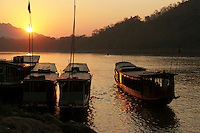 Mekong River Sunset - The Mekong River flows for over four thousand kilometers from the Tibetan Plateau through China then finally Indochina.  The Mekong riverfront in Luang Prabang is very much part of the town's cityscape as well as its lifeline to the rest of the country.
