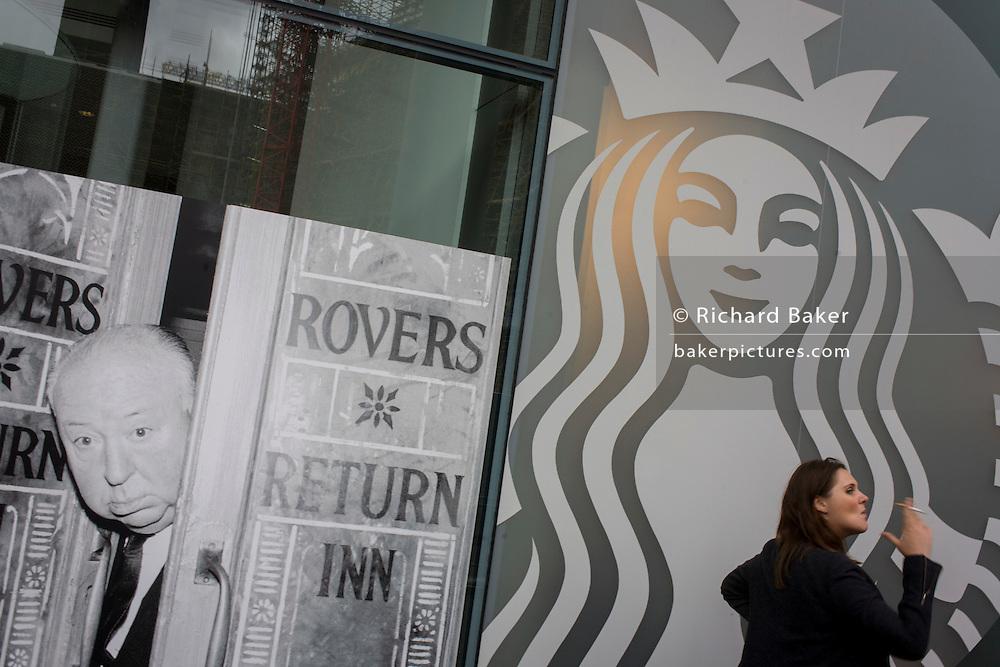 Photograph of film director Alfred Hitchcock on the Coronation Street TV soap set alongside the modern Starbucks logo.