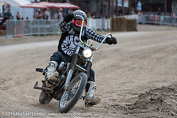 Danger Dan's Talk Shop podcaster and Hooligan flattracker Danger Dan Hardick (no. 13) on his Harley-Davidson Sportster chopper-racer in the Hooligan races on the temporary track in front of the Sturgis Buffalo Chip main stage during the Sturgis Black Hills Motorcycle Rally. SD, USA. Wednesday, August 7, 2019. Photography ©2019 Michael Lichter.