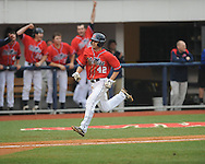 Ole Miss' Holt Perdzock (42) scores in the 7th inning vs. Lipscomb at Oxford-University Stadium in Oxford, Miss. on Sunday, March 10, 2013. Ole Miss won 9-8. The Rebels improve to 16-1.