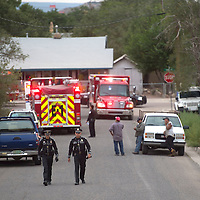 New Mexico State police officers walk away from the scene of an explosion on the north side of Gallup Wednesday.