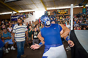 July 13, 2008 -- PHOENIX, AZ: Luchador Mr. Galaxy is in the grip of fellow luchador Syndromia during a Lucha Libre show at El Gran Mercado in Phoenix. Mr. Galaxy is the tecnico and Syndromia is the rudo. Lucha Libre is Mexican style wrestling. There are heros (Tecnicos) and villians (Rudos). The masks are popular as children's gifts and tourist mementos. As the size of the Mexican community in the Phoenix area has grown, attendance at the Lucha Libre shows has increased. Lucha Libre differs from American style entertainment wrestling in several ways, but principally the wrestlers are more acrobatic and rely less on body slams than American wrestling. The shows, which used to be held only periodically, are now held every week at El Gran Mercado, a flea market and swap meet that caters mostly to the Mexican community in Phoenix.   Photo by Jack Kurtz / ZUMA Press