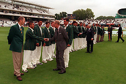 The Duke of Edinburgh is introduced to the South African cricket team with Captain Hansie Cronje (behind) in front of the new grandstand at Lords Cricket Ground before the start of play.