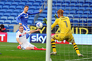 Cardiff City's Anthony Pilkington © is denied a goal by a save from Wigan goalkeeper Adam Bogdan (1) and a timely challenge from Wigan's Jake Buxton (on floor). EFL Skybet championship match, Cardiff city v Wigan Athletic at the Cardiff city stadium in Cardiff, South Wales on Saturday 29th October 2016.<br /> pic by Carl Robertson, Andrew Orchard sports photography.
