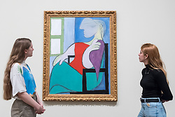 "© Licensed to London News Pictures. 06/03/2018. LONDON, UK.  Staff members view ""Seated Woman by a Window (""Femme assise pres d'une fenetre""), 1932, by Pablo Picasso. Preview of ""Picasso 1932 - Love, Fame, Tragedy"", the Tate Modern's first ever solo exhibition of the work of Pablo Picasso.   More than 100 paintings, sculptures and works on paper covering the year 1932, a pivotal time in Picasso's life, are on display 8 March to 9 September 2018. Photo credit: Stephen Chung/LNP"