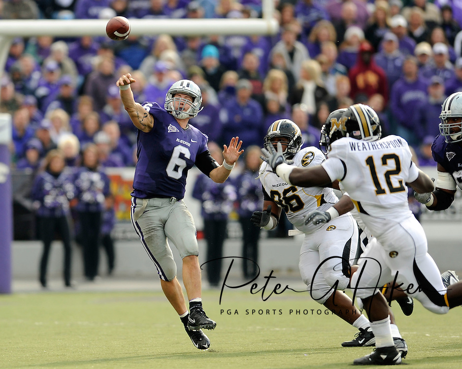 MANHATTAN, KS - NOVEMBER 14:  Quarterback Grant Gregory #6 of the Kansas State Wildcats throws the ball down field under pressure from defenders Jaron Baston #96 and Sean Weatherspoon #12 of the Missouri Tigers in the fourth quarter on November 14, 2009 at Bill Snyder Family Stadium in Manhattan, Kansas.  (Photo by Peter G. Aiken/Getty Images)